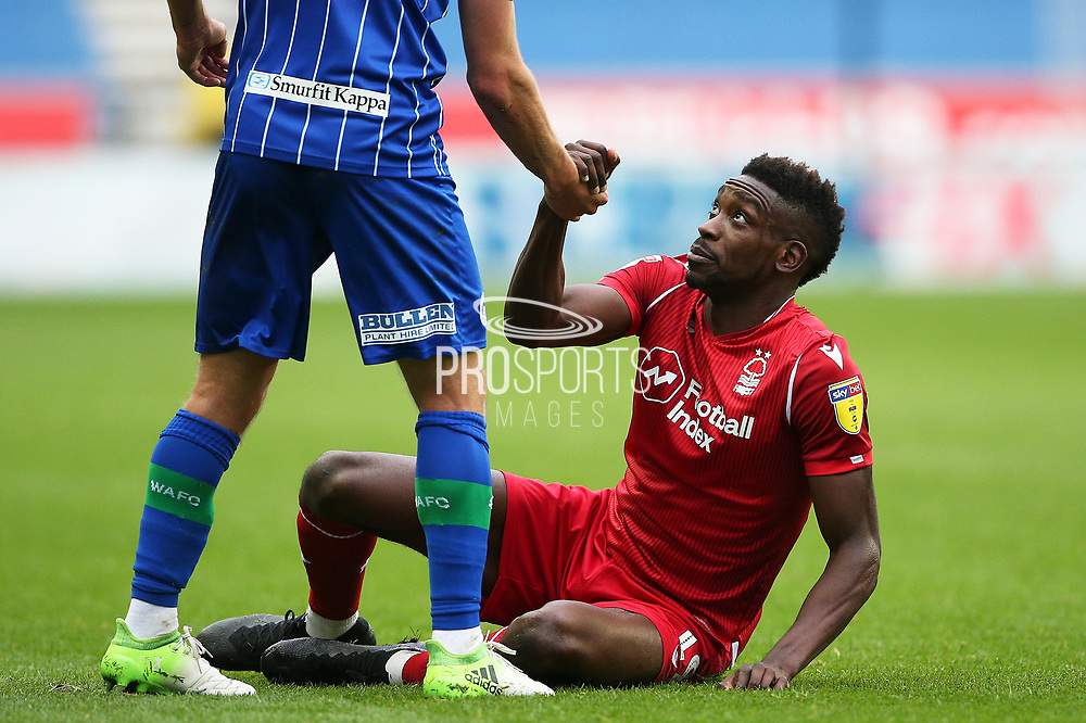 Nottingham Forest forward Sammy Ameobi (19) gets a helping hand from the opposition during the EFL Sky Bet Championship match between Wigan Athletic and Nottingham Forest at the DW Stadium, Wigan, England on 20 October 2019.