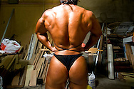 For two years in a row, in a rundown theater in Porto, the Portuguese National Championship of Bodybuilding WABBA happened. Several athletes, from allover the country came to this one day competition. <br /> These are photos from the backstage, where the athletes exercise and get body paint for the stage presentation. The muscles and the gold and brown colors get ready in the confusion of tubes, abandoned wood from different theater plays, photos from the past and dressing rooms with 100 years old. Eunice Miranda, former boxing champion in her first presentation.