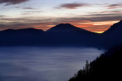 Sunrise over the rim of Crater Lake, Crater Lake National Park, Oregon, United States of America