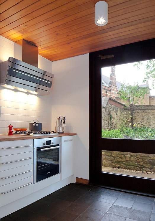 kitchen interior and view through back door looking out onto oxford colleges