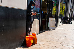 Week five of the Lockdown in Sheffield and  Covid-19 changes the face of shopping as some shoppers choose to wear facemasks, customers are required to wait outside shops and security guards administer new rules Sheffield <br /> <br /> 24 April 2020<br /> <br /> www.pauldaviddrabble.co.uk<br /> All Images Copyright Paul David Drabble - <br /> All rights Reserved - <br /> Moral Rights Asserted -