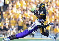 September 15 2012: Iowa Hawkeyes wide receiver Keenan Davis (6) pulls in a pass as he is hit by Northern Iowa Panthers defensive back Edwin Young (27) during the second half of the NCAA football game between the Northern Iowa Panthers and the Iowa Hawkeyes at Kinnick Stadium in Iowa City, Iowa on Saturday September 15, 2012. Iowa defeated Northern Iowa 27-16.