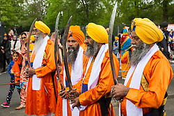 Slough, UK. 28th April 2019. The Panj Pyare (Five Beloved Ones) take part in the Vaisakhi Nagar Kirtan procession from the Gurdwara Sri Guru Singh Sabha to the Ramgarhia Sikh Gurdwara. Vaisakhi is the holiest day in the Sikh calendar, a harvest festival marking the creation of the community of initiated Sikhs known as the Khalsa.