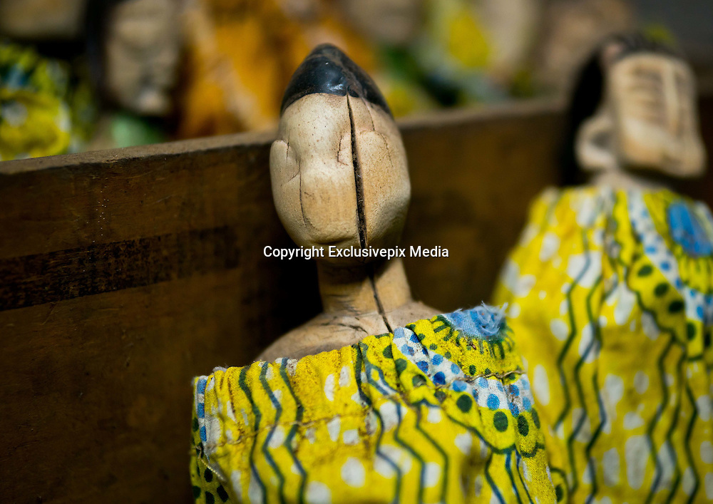 Benin&rsquo;s Living Dead: The Voodoo Twins Tradition<br /> <br /> 40% of the world&rsquo;s twins are born in Africa. Benin&rsquo;s Fon people have one of the highest occurrences at 1 in 20 births. The high rate of infant mortality and voodoo religion, Benin&rsquo;s national religion, have begot some very particular practices concerning the deaths of one or both of these twins. In many other societies, twins are regarded as bad omens and often killed or abandoned at birth. However, in the Fon culture, twins have always been revered because Nana Buluku, voodoo&rsquo;s androgynous creator of the universe, gave birth to twins. These twins in turn created the voodoo deities that run the world.<br /> <br /> Once a twin dies, a wooden statue called the &ldquo;hohovi&rdquo; is carved, within which the spirit of the dead child is placed. These figurines are deified and treated almost exactly like the living children. For the Fon, twins are immortal. They continue to live even after their death, bringing blessings or misfortune depending on if there are either pampered or abused.<br /> <br /> Three months after the birth of twins, if they are still living, the parents go collect gifts from other members of their community. If one or both of the twins die, then the mother carries the statues around between her breasts and walks around with a tray on her head, receiving alms for the twins.  All donate some money or food. The mother may even take some wares on display at the market. If a woman is rich or powerful, then she sends someone to conduct this collection in her place. <br /> <br /> In Bopa, a village situated on the banks of Lake Aheme in southern Benin, Dah Tofa and his wife reside. Dah Tofa, an educated man in his 60s, is a voodoo priest. His wife, who is around 40 years old, speaks only Fon. I ask for her name and she tells me the name she was born with, but this causes a bit of an incident. Her husband explains that she was supposed to say &ldquo;Hounyoga&rdquo;, t