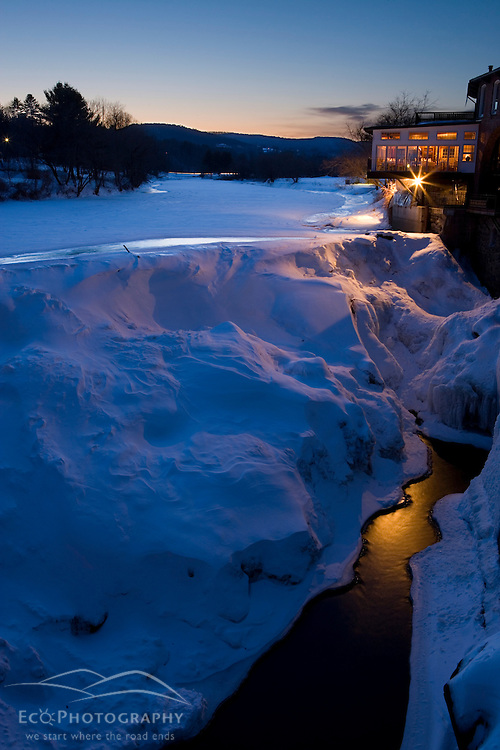 Night falls on the Ottauquechee River and the Simon Pearce Gallery and Restaurant in Quechee, Vermont.