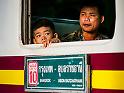 11 APRIL 2018 - BANGKOK, THAILAND:  A boy looks out the window of his train carriage in Hua Lamphong train station in Bangkok on the first day of the Songkran travel period. Songkran is the traditional Thai New Year and is one of the busiest travel periods of the year as Thais leave the capital and go back to their home provinces or resorts in tourist areas. Trains and busses are typically jammed the day before the three day Songkran holiday starts. The government has extended the official holiday period through Monday, 16 April because one day of the Songkran holiday fell on the weekend, giving many workers a five day holiday.     PHOTO BY JACK KURTZ