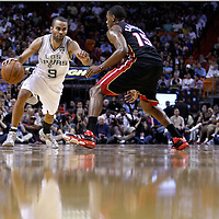 14 March 2011: San Antonio Spurs point guard Tony Parker (9) drives past Miami Heat point guard Mario Chalmers (15) during the Miami Heat 110-80 victory over the San Antonio Spurs at the AmericanAirlines Arena, Miami, Florida, USA.