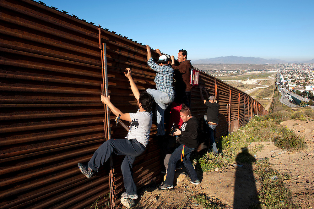 Cantamo, Reggae and Ska band, at the border fence in Tijuana.  ..© Stefan Falke.http://www.stefanfalke.com/..