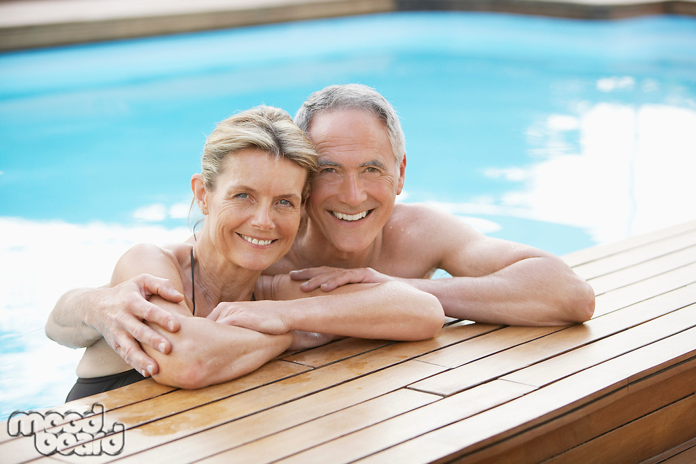 Senior Couple Relaxing in Swimming Pool