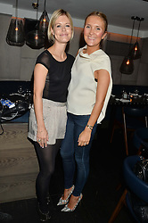 Left to right, OLIVIA FOSTER MITCHELL and GABRIELLA GUTHRIE at a dinner to celebrate London Fashion Week SS 2015 and the opening of Ramusake at 92 Old Brompton Road, London on 15th September 2014.