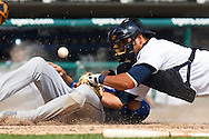 April 14, 2010:  Kansas City Royals' David DeJesus (9) slides into home and Detroit Tigers' Gerald Laird (8) drops the ball during the MLB baseball game between the Kansas City Royals vs Detroit Tigers at  Comerica Park in Detroit, Michigan.