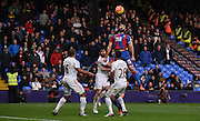 Mile Jedinak leaps highest for the header during the Barclays Premier League match between Crystal Palace and Swansea City at Selhurst Park, London, England on 28 December 2015. Photo by Michael Hulf.