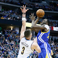 13 February 2017: Golden State Warriors forward Draymond Green (23) goes for the jump shot over Denver Nuggets guard Mike Miller (3) during the Denver Nuggets 132-110 victory over the Golden State Warriors, at the Pepsi Center, Denver, Colorado, USA.