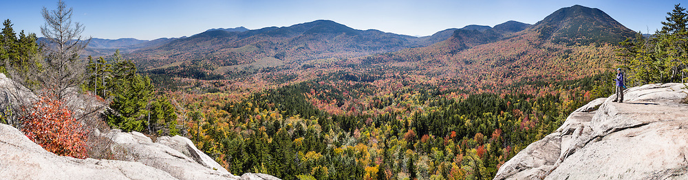 "For views of fall leaf colors and Mount Passaconaway (4043 ft) in White Mountain National Forest, hike the rocky UNH Loop Trail (4.8 miles, 1600 feet gain) on Hedgehog Mountain in the Sandwich Range Wilderness in New Hampshire, USA. The peak intensity of autumn foliage color here is around the first week of October. Find the trailhead parking area marked ""Downes Brook - UNH - Mt. Potash Trails"" along Kancamagus Highway (NH Route 112) across from Passaconaway Campground and Passaconaway Historic Site. The White Mountains (a range in the northern Appalachians) cover a quarter of the state of New Hampshire. The panorama was stitched from 6 overlapping photos."
