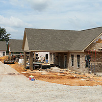 Three of the first five cabins under construction at the Itawamba Crossroads Ranch.