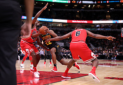 October 26, 2017 - Chicago, IL, USA - The Chicago Bulls' Kay Felder (20) and Cristiano Felicio (6) defend against the Atlanta Hawks' Isaiah Taylor (22) in the first half at the United Center in Chicago on Thursday, Oct. 26, 2017. The Bulls won, 91-86. (Credit Image: © Chris Sweda/TNS via ZUMA Wire)
