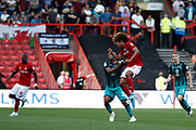 Bristol City's Han-Noah Massengo heads the ball and is challenged by Swansea City forward Andre Ayew during the EFL Sky Bet Championship match between Bristol City and Swansea City at Ashton Gate, Bristol, England on 21 September 2019.