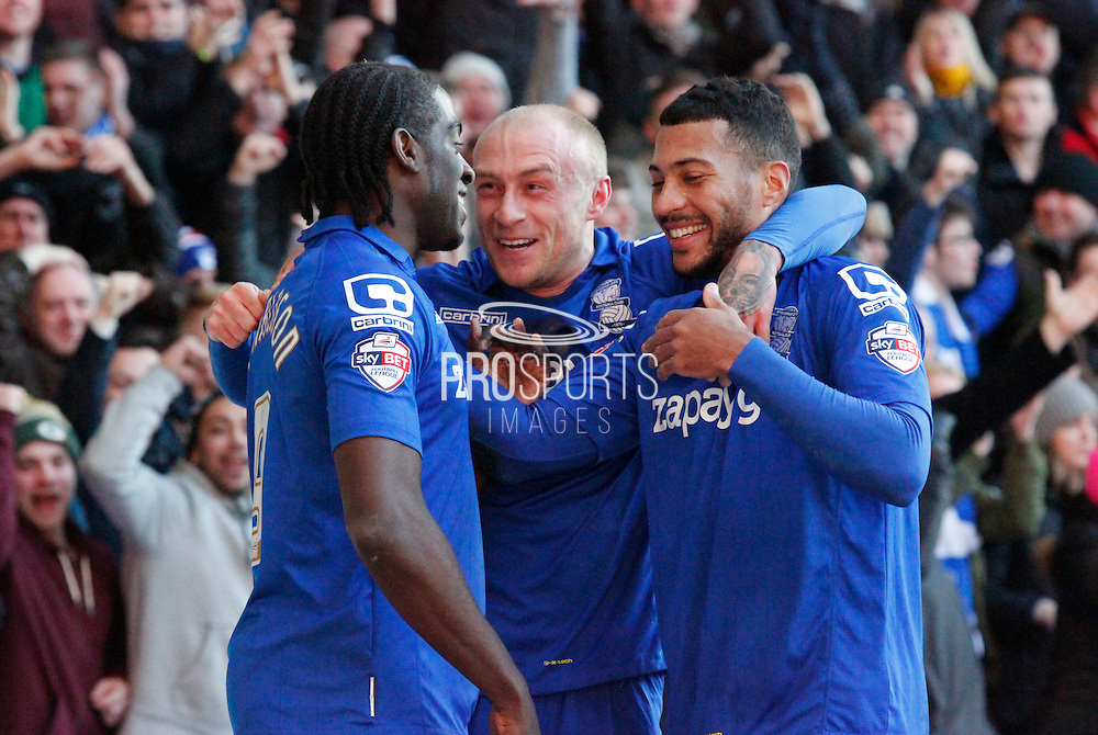 Clayton Donaldson celebrates with David Cotterill and David Davis during the Sky Bet Championship match between Nottingham Forest and Birmingham City at the City Ground, Nottingham, England on 28 December 2014. Photo by Jodie Minter.