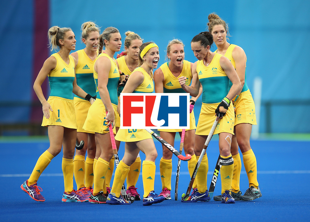 RIO DE JANEIRO, BRAZIL - AUGUST 10:  Australia players celebrate as Jodie Kenny of Australia scores a penalty stroke goal during the Women's Pool B Match between India and Australia on Day 5 of the Rio 2016 Olympic Games at the Olympic Hockey Centre on August 10, 2016 in Rio de Janeiro, Brazil.  (Photo by Mark Kolbe/Getty Images)