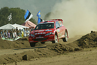 Norway's driver Henning Solberg and his compatriot co-driver carlo menkerud control their Peugeot 206 WRC in the Loelle Special Stage on the first day of the Rally of Sardinia, Italy, October 1, 2004.
