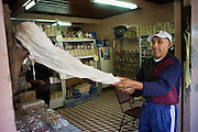 Man pulling taffy, shop, Banos, Ecuador