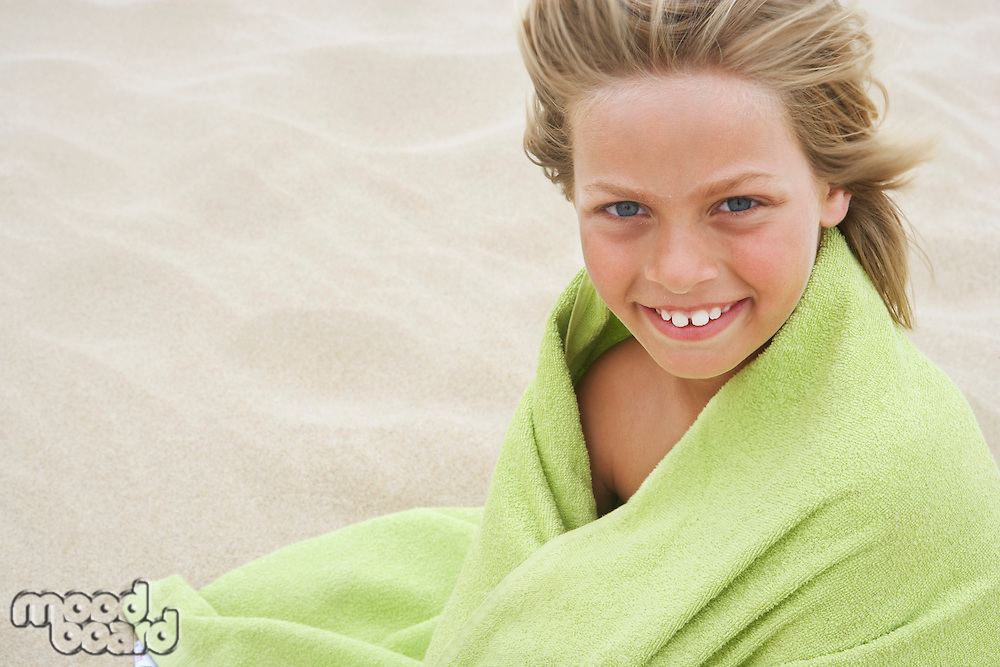 Girl Wrapped in Towel at Beach