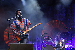 © Licensed to London News Pictures . 19/07/2013 . Suffolk , UK . Kele Okereke of Bloc Party , performing on the Obelisk Stage . The Latitude music and culture festival in Henham Park , Southwold . Photo credit : Joel Goodman/LNP