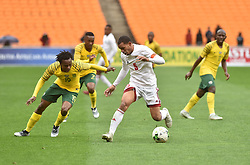 South Africa: Johannesburg: Bafana Bafana player Percy Tau battle for the ball with Seychelles player Jones Joubert during the Africa Cup Of Nations qualifiers at FNB stadium, Gauteng.<br />