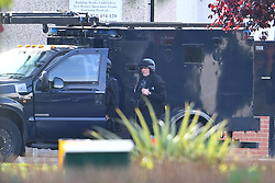 © Licensed to London News Pictures. 22/10/2016. London, UK. Armed police surround a house in Northolt. Police attended an address in Wood End Lane, Northolt at shortly just after midnight on Friday after a report of concerns for the occupant and hazardous items inside the property. Police believe a man is still inside the house. Photo credit: Ben Cawthra/LNP