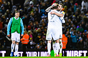 Leeds United defender Liam Cooper (6) and Leeds United forward Patrick Bamford (9) reacts at full time during the EFL Sky Bet Championship match between Leeds United and Millwall at Elland Road, Leeds, England on 28 January 2020.