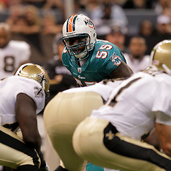 2009 September 03: Miami Dolphins linebacker Joey Porter (55) lines up for a play during a preseason game between the Miami Dolphins and the New Orleans Saints at the Louisiana Superdome in New Orleans, Louisiana.