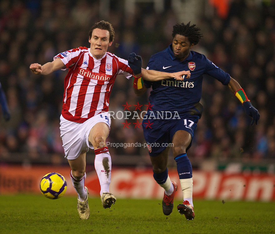 STOKE-ON-TRENT, ENGLAND - Saturday, February 27, 2010: Arsenal's Alexandre Song Billong and Stoke City's Dean Whitehead during the FA Premier League match at the Britannia Stadium. (Photo by David Rawcliffe/Propaganda)