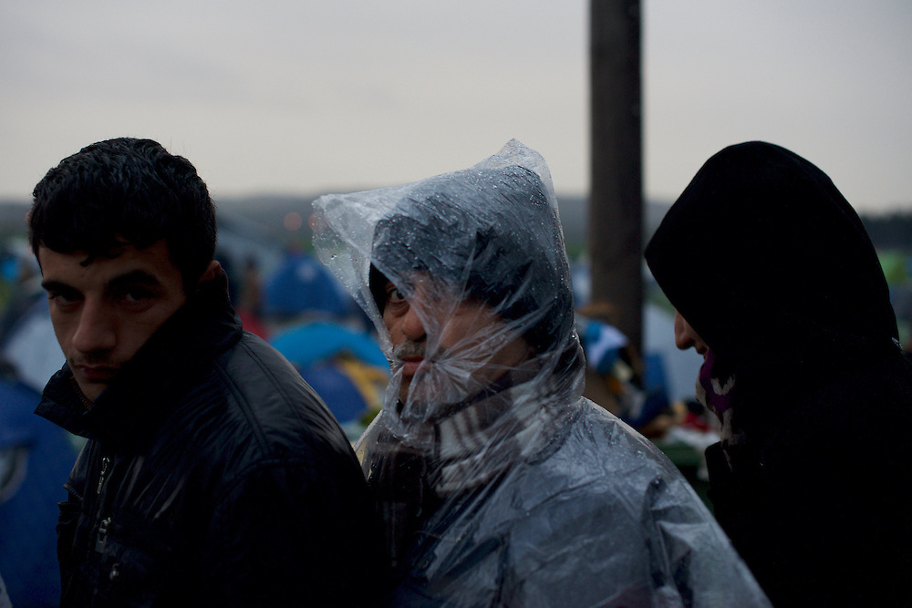 Migrants and refugees queue for food distribution at the border between Greece and Macedonia in Idomeni, Greece. Around 13,000 migrants and refugees, mostly from the Middle East and African nations, are believe to be stranded here awaiting a chance to proceed their journey towards Germany and other northern European countries.