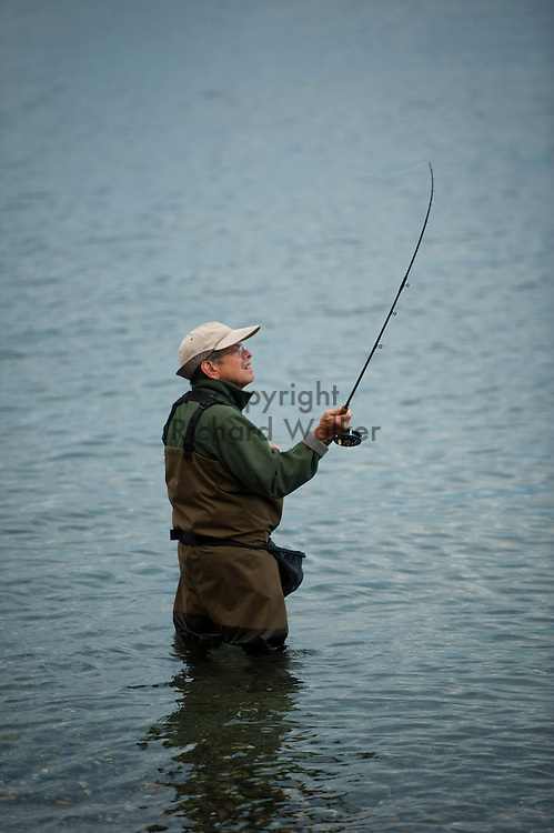 2011 August 15 - A man casts into Puget Sound from the shore of Lincoln Park in West Seattle. Fishermen crowded the beach fishing for pink salmon. Photo by Richard Walker