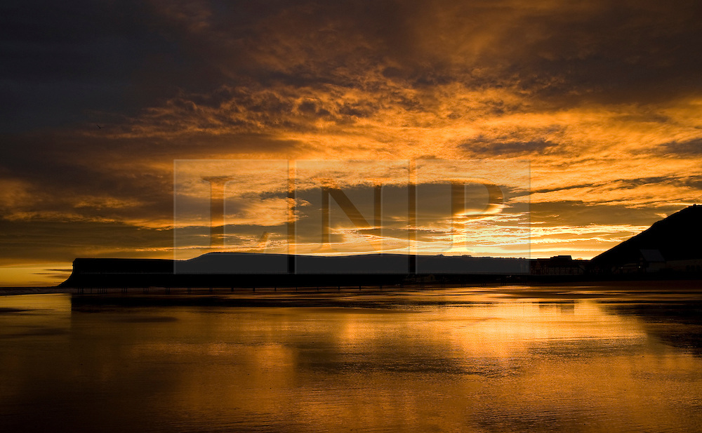 © Licensed to London News Pictures. 09/01/2012..Saltburn, England. ..A spectacular sunrise is seen over the Cleveland town of Saltburn by the Sea...Photo credit : Ian Forsyth/LNP