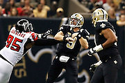 NEW ORLEANS, LA - NOVEMBER 11:  Drew Brees #9 of the New Orleans Saints throws a pass under pressure from Jonathan Babineaux #95 of the Atlanta Falcons at Mercedes-Benz Superdome on November 11, 2012 in New Orleans, Louisiana.  The Saints defeated the Falcons 31-27.  (Photo by Wesley Hitt/Getty Images) *** Local Caption *** Drew Brees; Jonathan Babineaux