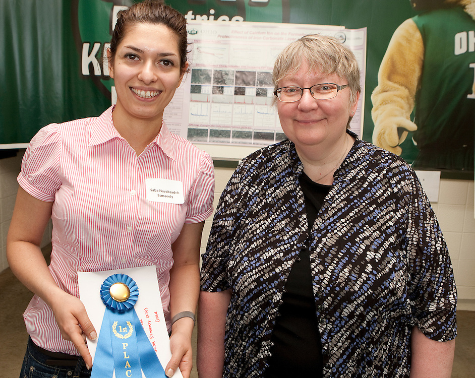 Saba Navabzadeh Esmaeely, left, and Pam Benoit, right, pose for a picture after Saba won a first place prize at the Student Show.
