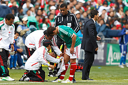 March 26, 2011; Oakland, CA, USA;  Mexico midfielder Javier Hernandez (14) is attended to by trainers on the sidelines against Paraguay during the first half at Oakland-Alameda County Coliseum. Mexico defeated Paraguay 3-1.