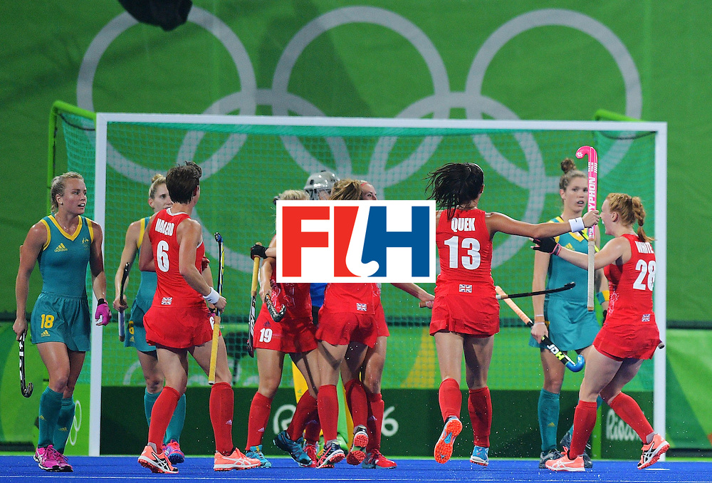 Britain's Sophie Bray (2R) and Shona McCallin (C) celebrate a goal with teammates during the women's field hockey Britain vs Australia match of the Rio 2016 Olympics Games at the Olympic Hockey Centre in Rio de Janeiro on August, 6 2016. / AFP / Carl DE SOUZA        (Photo credit should read CARL DE SOUZA/AFP/Getty Images)