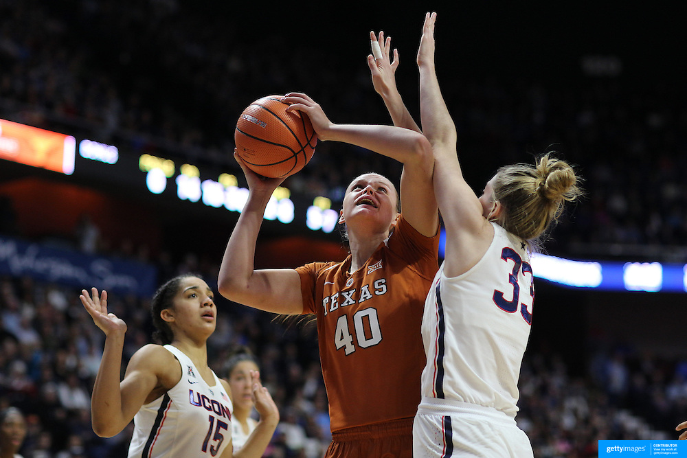 UNCASVILLE, CONNECTICUT- DECEMBER 4:  Kelsey Lang #40 of the Texas Longhorns ldrives to the basket while defended by Katie Lou Samuelson #33 of the Connecticut Huskies during the UConn Huskies Vs Texas Longhorns, NCAA Women's Basketball game in the Jimmy V Classic on December 4th, 2016 at the Mohegan Sun Arena, Uncasville, Connecticut. (Photo by Tim Clayton/Corbis via Getty Images)