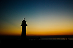 © Licensed to London News Pictures. <br /> 09/04/2017<br /> Whitby, UK. <br />  <br /> The first light of day reaches over the harbour  and lighthouse in Whitby in North Yorkshire. <br /> <br /> <br /> Photo credit: Ian Forsyth/LNP