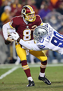 Dallas Cowboys defensive end Demarcus Lawrence (90) knocks the ball loose as he sacks Washington Redskins quarterback Kirk Cousins (8) on the third play of the first quarter causing a fumble and setting the tone for a defensive struggle during the 2015 week 13 regular season NFL football game against the Washington Redskins on Monday, Dec. 7, 2015 in Landover, Md. The Cowboys won the game 19-16. (©Paul Anthony Spinelli)