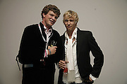 JACK KIDD AND RICK PARFITT, The BladeRun Send-off party. The Henry Moore Gallery SW7, Royal College of Art. 16 August 2006.  ONE TIME USE ONLY - DO NOT ARCHIVE  © Copyright Photograph by Dafydd Jones 66 Stockwell Park Rd. London SW9 0DA Tel 020 7733 0108 www.dafjones.com