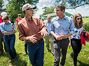 07 JUNE  2019 - LACONA, IOWA: MATT RUSSELL, left, co-owner of Coyote Run Farm, talks to BETO O'ROURKE, and his wife, AMY O'ROURKE, while they tour Coyote Run Farm. O'Rouke toured Coyote Run Farm in Lacona Friday. He talked to Russell, the farm's co-owner, about the impact of President Trump's tariffs against China and proposed tariff's against Mexico on Iowa farmers and how climate change was changing American agriculture. O'Rourke, running to be the 2020 Democratic nominee for the US Presidency, has made climate change a central part of his campaign. Iowa traditionally hosts the the first selection event of the presidential election cycle. The Iowa Caucuses will be on Feb. 3, 2020.                               PHOTO BY JACK KURTZ