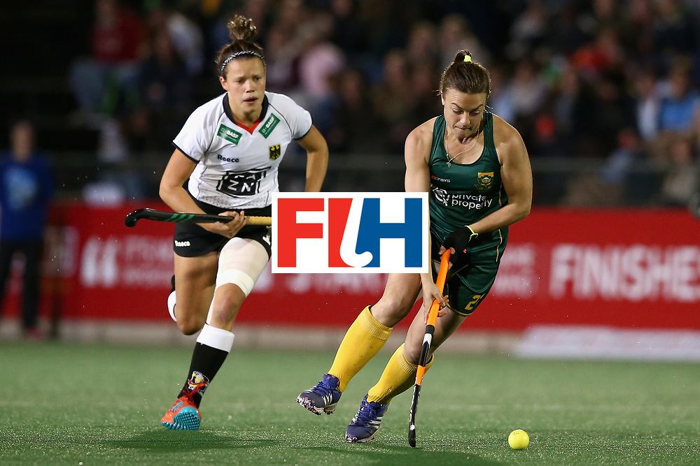 JOHANNESBURG, SOUTH AFRICA - JULY 18: Jade Mayne of South Africa attempts to get away from Charlotte Stapenhorst of Germany during the Quarter Final match between Germany and South Africa during the FIH Hockey World League - Women's Semi Finals on July 18, 2017 in Johannesburg, South Africa.  (Photo by Jan Kruger/Getty Images for FIH)