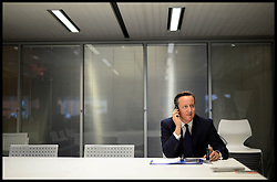 Image ©Licensed to i-Images Picture Agency. 28/09/2014. Birmingham, United Kingdom. The Prime Minister David Cameron being interviewed by Andrew Marr for the BBC Marr show in Birmingham on Day one of the 2014 Conservative Party Conference. Picture by Andrew Parsons / i-Images