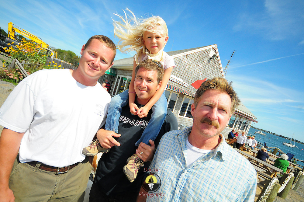 "9/7/09 - HARPSWELL, Maine -- New owners, Chris , left, and Billy Saxton of Dolphin Marina have taken over operations from Bill, right, their father (who is staying on as a co-owner). They plan on making changes to the family-run property in the coming months. They will increase the size of the restaurant, adding tables -- but keeping the ""charm"" of the location. They also plan on increasing to over 100 moorings in the bay.  Photo by Roger S. Duncan"