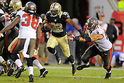 New Orleans Saints running back Mark Ingram (22) runs upfield during the Saints game against the Tampa Bay Buccaneers at Raymond James Stadium on Sept. 15, 2013 in Tampa, Florida. <br /> &copy;2013 Scott A. Miller