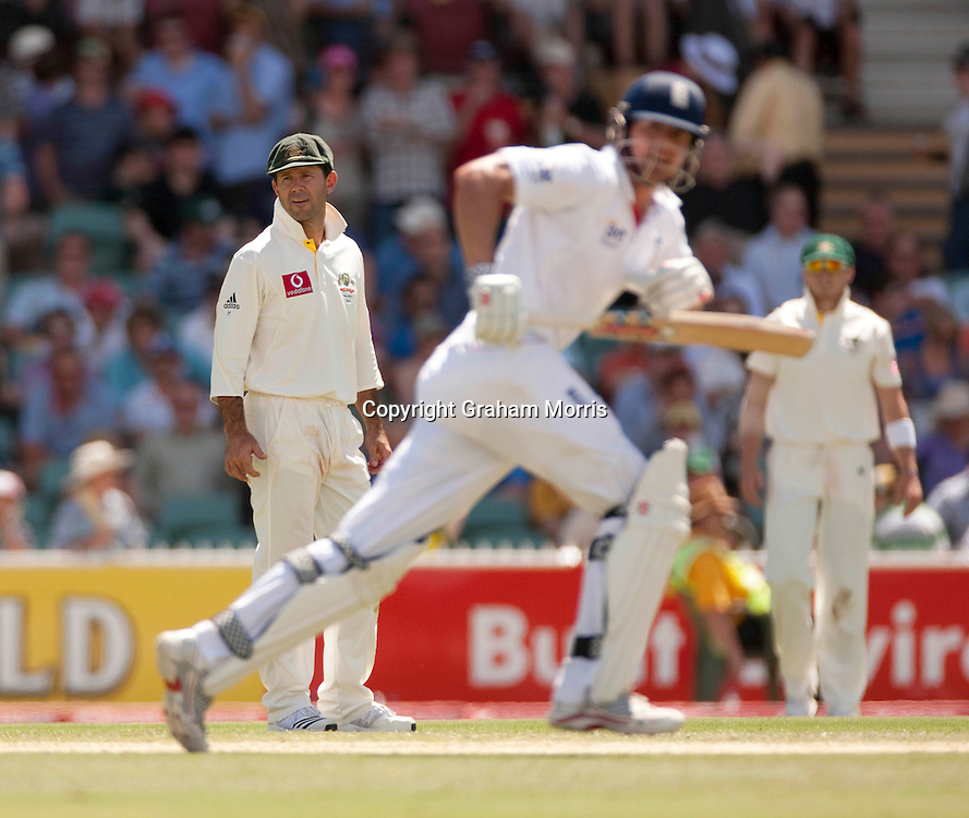 Captain Ricky Ponting watches Alastair Cook (foreground) run during the second Ashes Test Match between Australia and England at the Adelaide Oval. Photo: Graham Morris (Tel: +44(0)20 8969 4192 Email: sales@cricketpix.com) 4/12/10