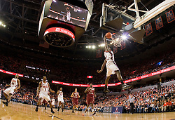Virginia guard/forward Mamadi Diane (24) delivers a one handed dunk against BC.  The Virginia Cavaliers men's basketball team defeated the Boston College Golden Eagles 84-66 at the John Paul Jones Arena in Charlottesville, VA on January 19, 2008.